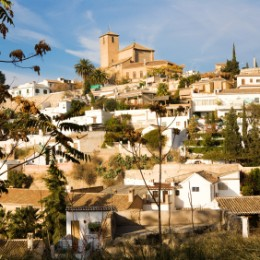 View of Albayzin, Granada, Spain. On top of the hill San Cristób